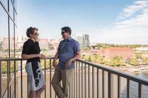 Couple taking on balcony of Wilmington apartments for rent