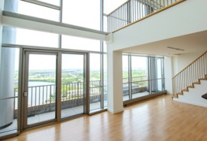 Spacious two-story apartment with large windows at The Residences at Christina Landing