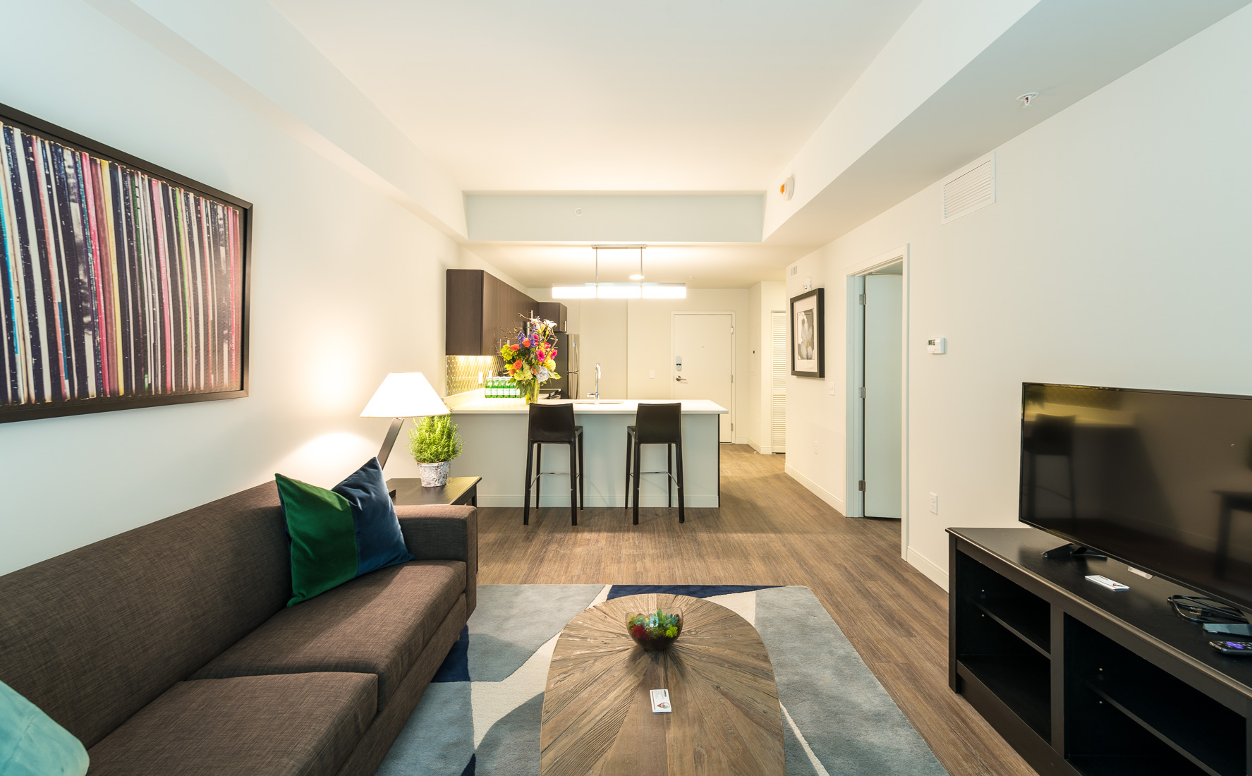 Spacious furnished living room and kitchen at The Residences at Midtown Park