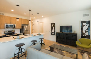 Open floor plan with furnished living room and kitchen at The Concord apartments