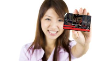 woman holding play where you live card