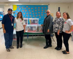 ResideBPG associates donate supplies to Lewis Elementary School